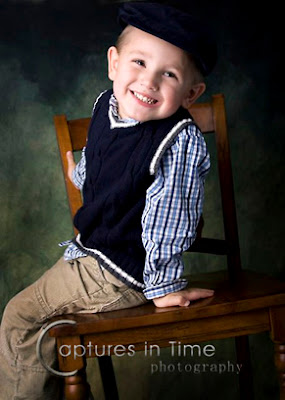 Kansas City Child Pics boy smiling on chair with green backdrop