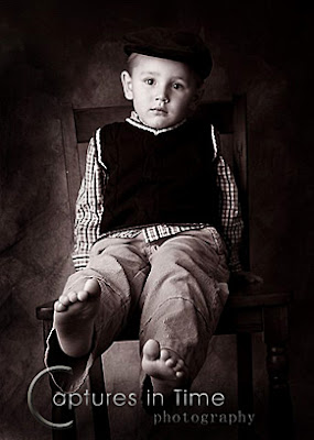 Kansas City Child Photography boy in a chair in black and white