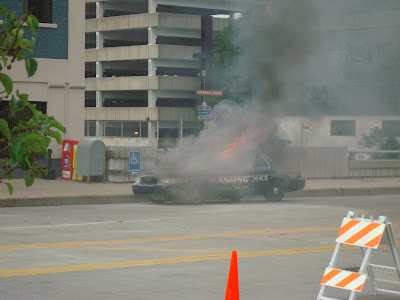 lansing police car burns obama