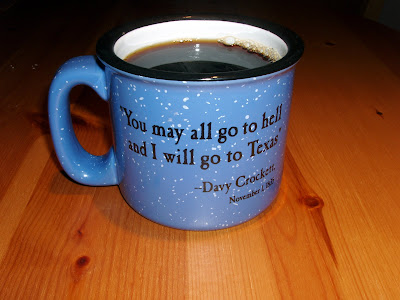 A mug from the Bob Bullock Museum, with a famous Davy Crockett quote.