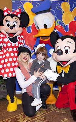 Christina Aguilera and Max celebrating at Disneyland