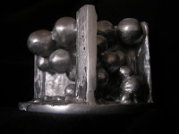 Aluminum Sculpture - side view of negative space for cat eye boulder, no color filter