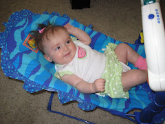Hannah and her aquarium bouncy seat