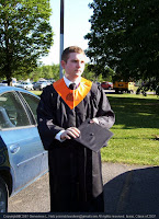 Our son in graduation garb: cap and gown