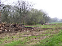 Rubble of two burned barns