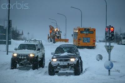 running red light in snow storm