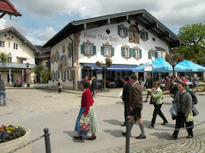 Locals stroll in their Sunday-best dirndls and lederhosen in Oberammergau. Photograph by Janie Robinson, Travel Writer