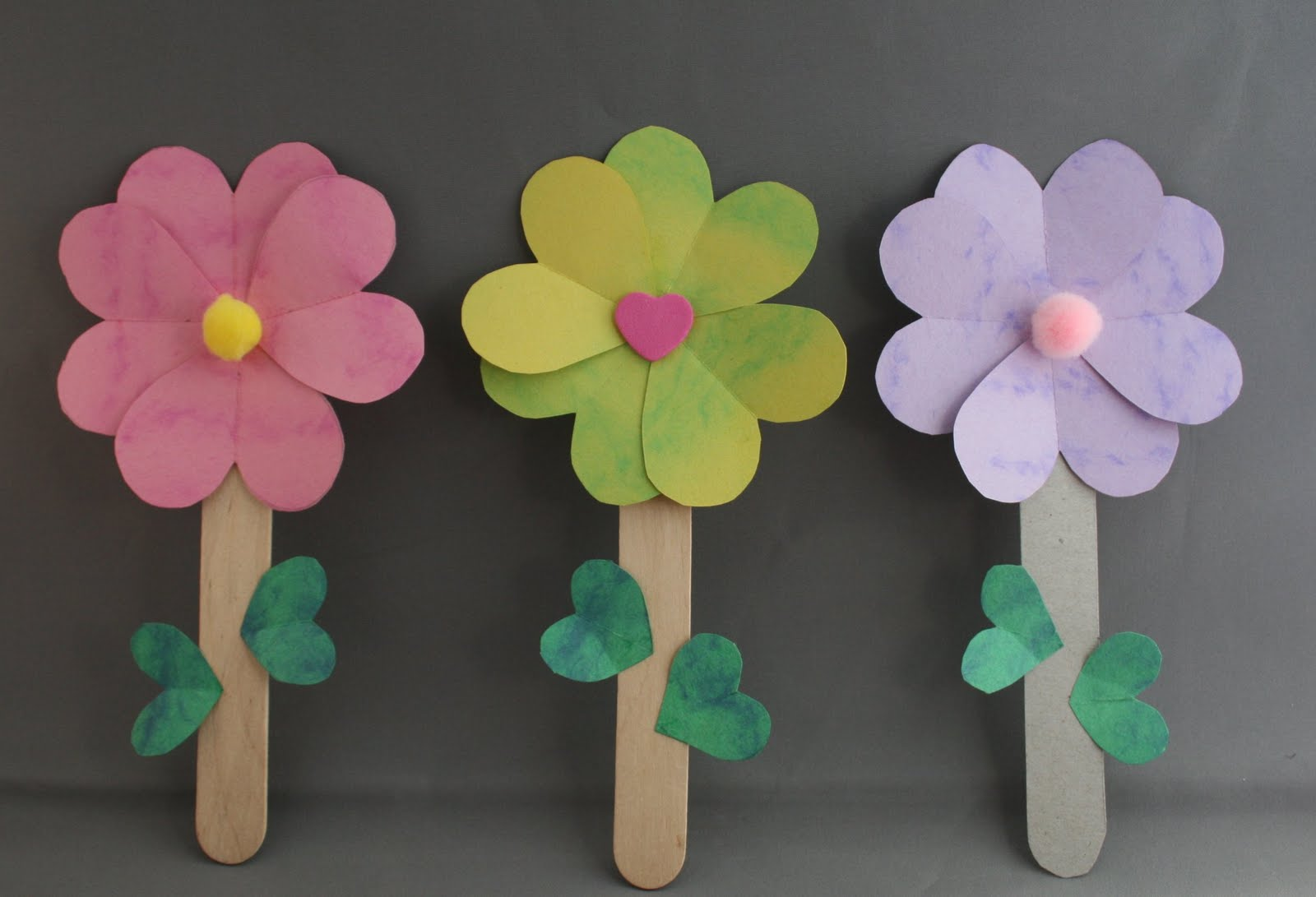 Ruhi Crafts  The Flowers of One Garden The construction details are include on the site so I will not repeat them   http   www familycorner com family kids crafts heart flowers shtml