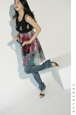 906eb9bc oversized white top, black small vest, skinnies