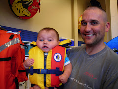 Kaeden trying on life vests