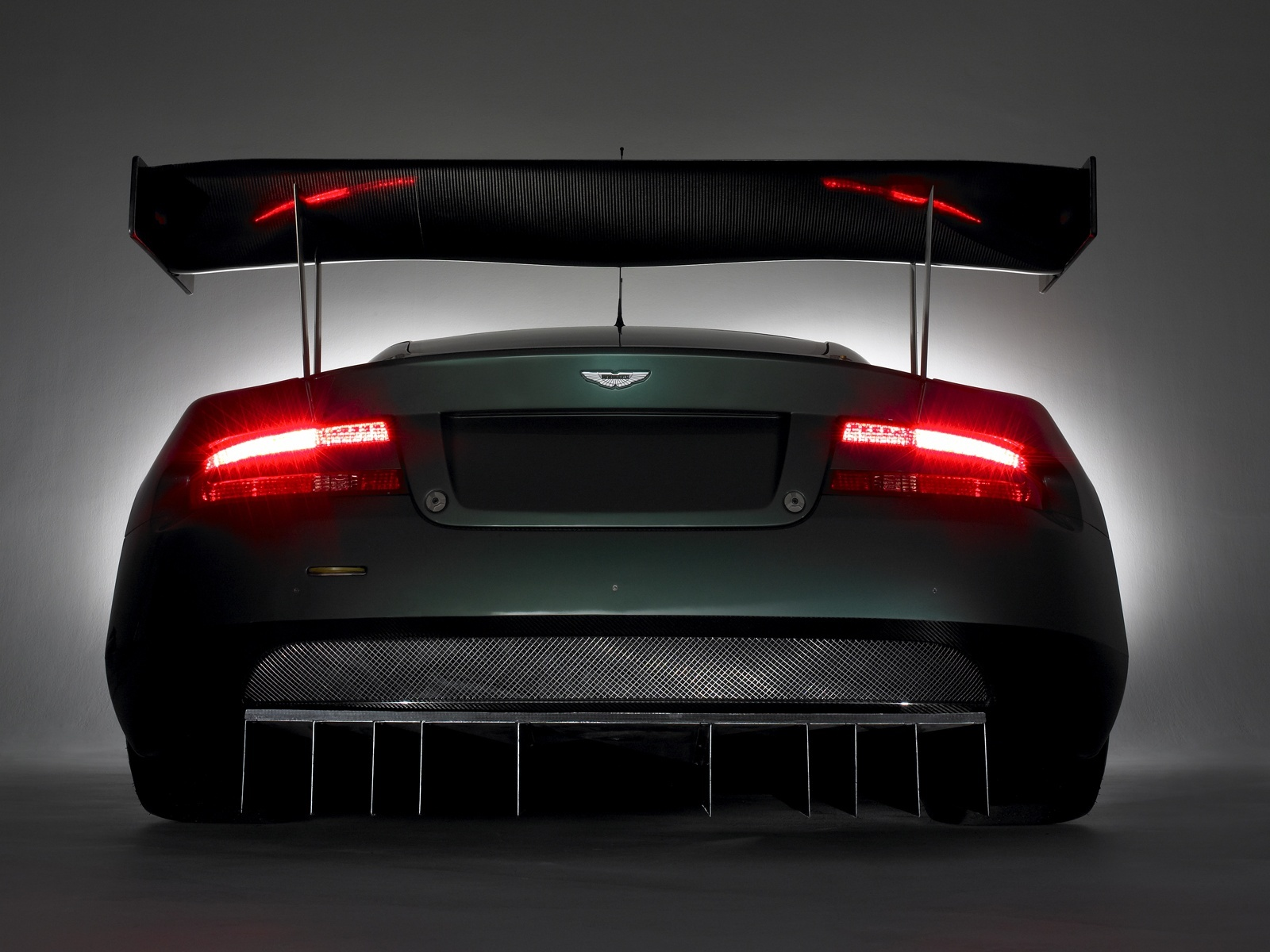 aston martin dbr9 red lights 1600x1200 Wallpapers Of Cars Hd