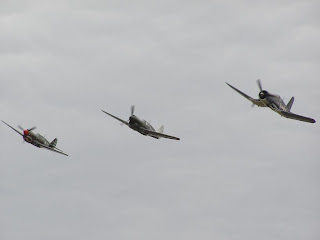 Two P40 Kittihawks and a Vought F4U Corsair