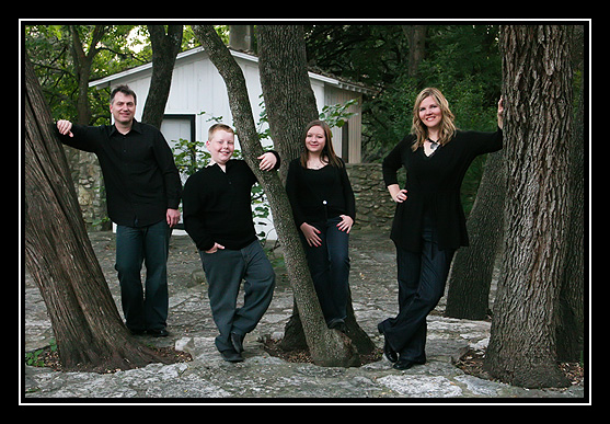 [family+standing+by+trees.jpg]