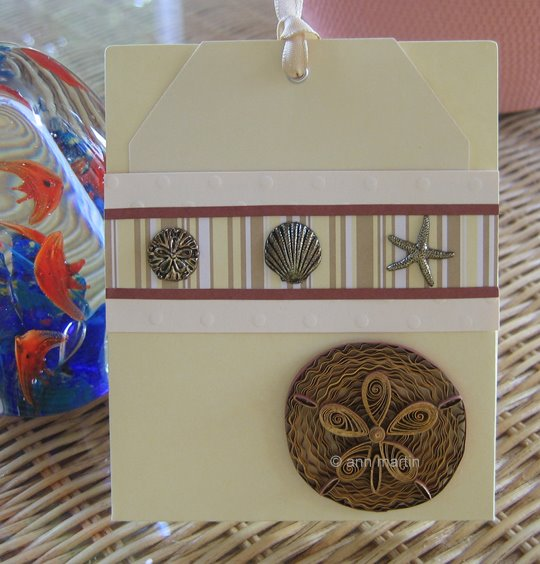 quilled sand dollar card with metal seashell charms