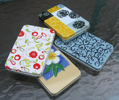 several shallow rectangular tins for packaging jewelry