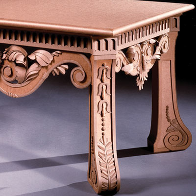 ornately carved cardboard table