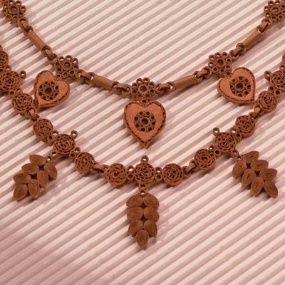 ornate quilled necklace made of cardboard