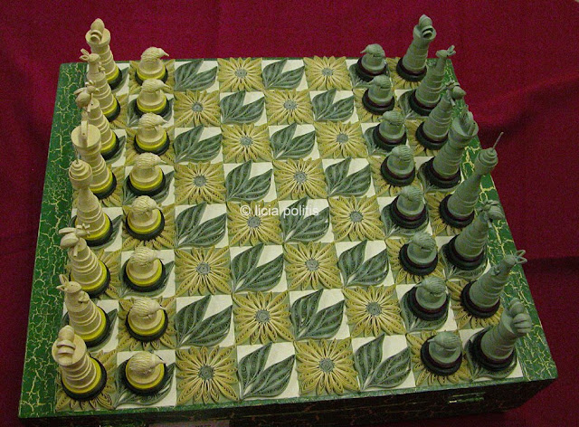 quilled chess set in gold and green with Australian-themed pieces