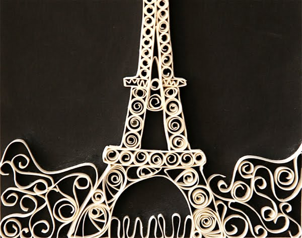 quilled eiffel tower on black background