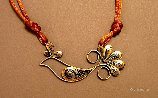 quilled gold bird pendant on bronze silk cording