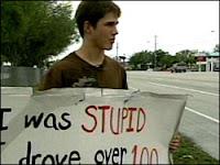 Teen wears 'stupid' sign