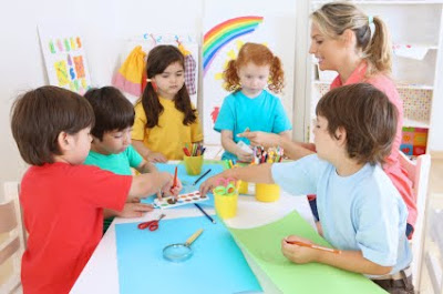 NAMC montessori classroom character education ideas children painting together