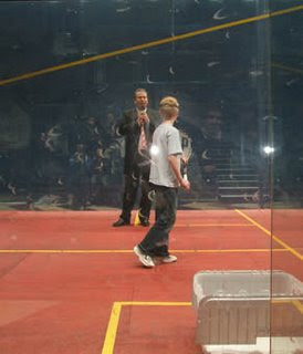 Alan Thatcher on court with a young member of the audience during the build-up