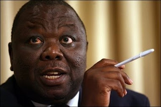 Morgan Tsvangiai, sucking on a long White Phallic object