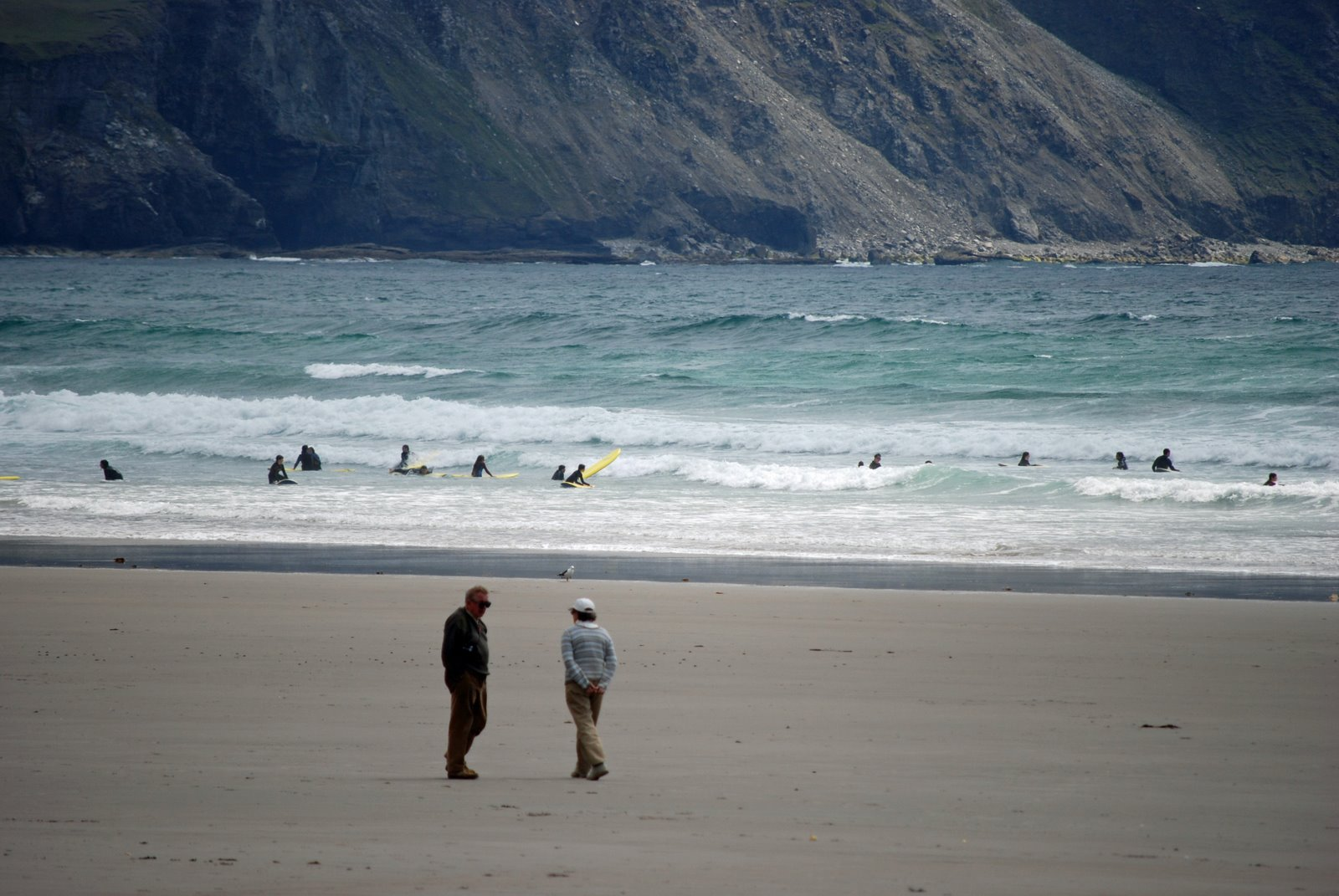 surfers, trawmore strand at keel, achill island