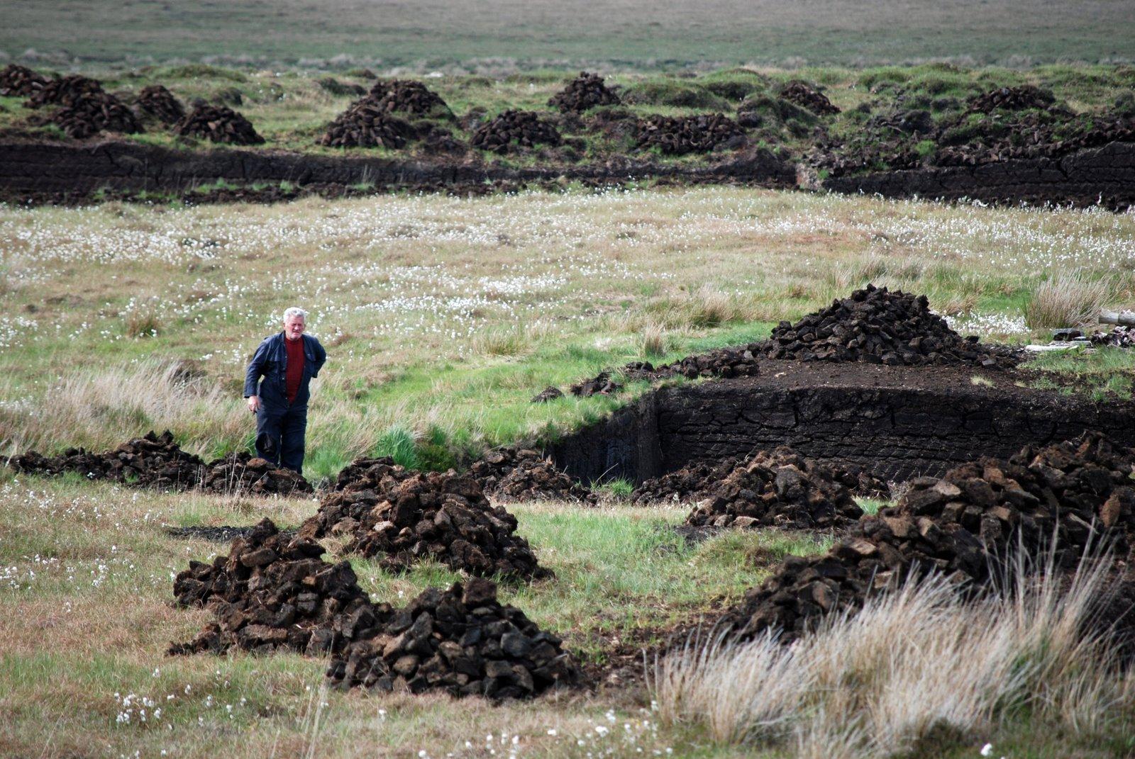 stacking peat, achill island, ireland
