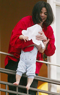 michael-jackson-holding-baby-wants-to-adopt.jpg