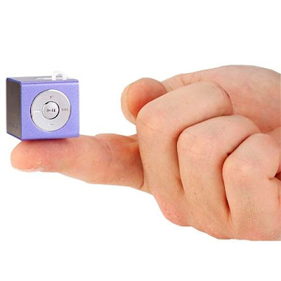 Smallest MP3 cube player placed on finger tip
