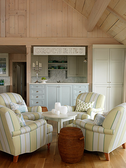 Charming conversational area with four club chairs and knotty pine paneling in lakehouse