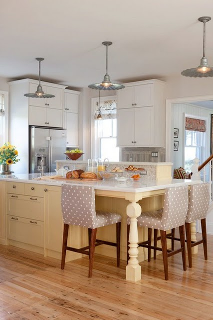 Sarah Richardson's charming yellow farmhouse kitchen with galvanized barn style lights on Hello Lovely