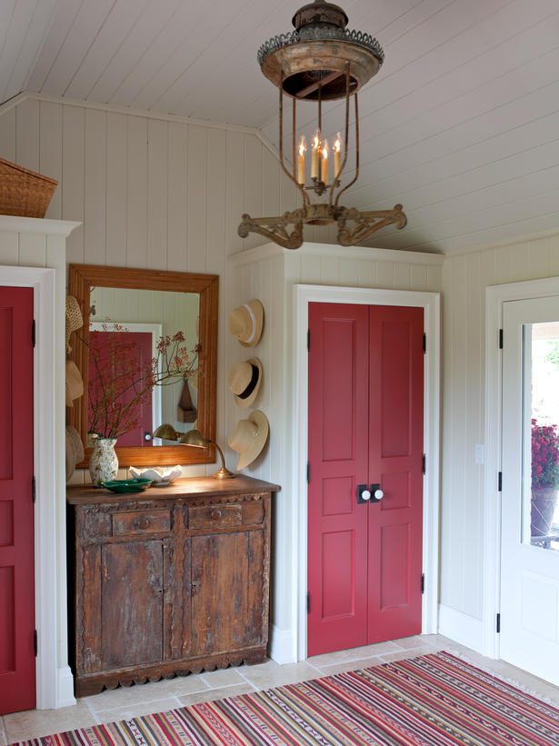 Cherry red vintage closet doors in farmhouse entry with beadboard shiplap