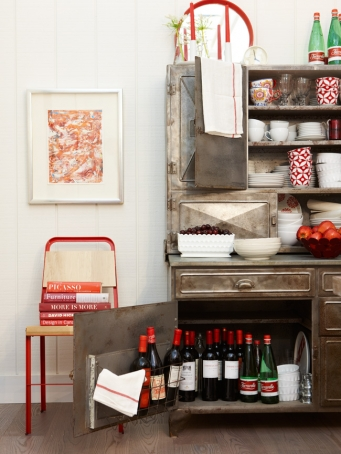 Modern farmhouse cabinet with red accents