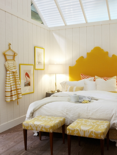 Bright yellow upholstered headboard and shiplap in a modern farmhouse bedroom by Sarah Richardson