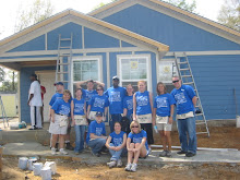 EC Students working with Habitat for Humanity