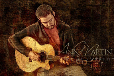 artists blend portrait of Russell Huie with his acoustic guitar