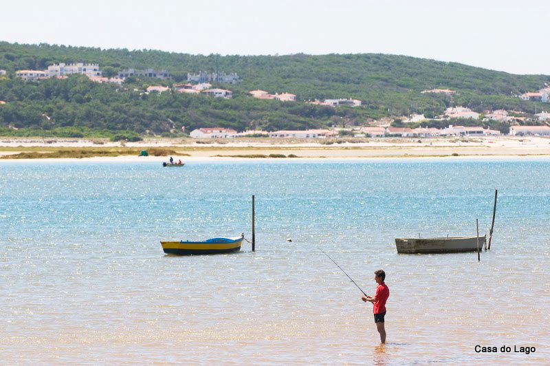 Holidays in Portugal, fishing on Obidos lagoon, viewed from Foz do Arelho