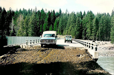 Driving on newly repaired Lewis River Road bridge Gifford Pinchot National Forest Washington