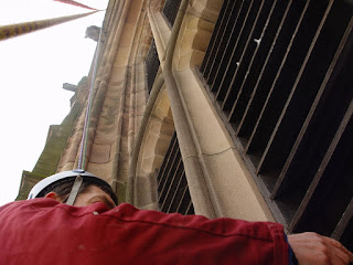 Just hanging about. Nick Evans - the man who built our peregrine platform - demonstrates the overhanging nature of Derby Cathedral Tower. Photographed in 2006.