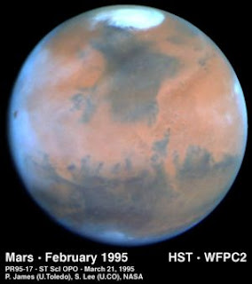 polar ice caps on Mars as seen by the Hubble`s Telescope