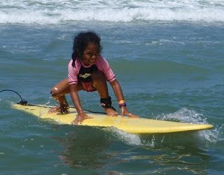 Camper Clarissa was only 6 when she learned to surf at Aloha Beach Camp Summer Camp in Los Angeles. Some kids are ready for a camp experience when they're very young, while others may need to wait a year or more before spending time away from home at camp.