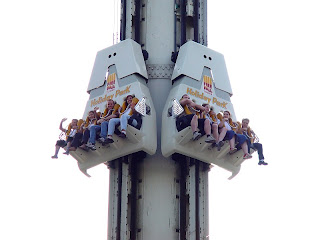 A theme park ride and the people aboard it is shown as a metaphor for the Record Den chain in 1997. No employees of the chain are visible in this photograph. We swear.