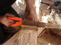 Fabrice using a cheap Frence saw to make the roof truss