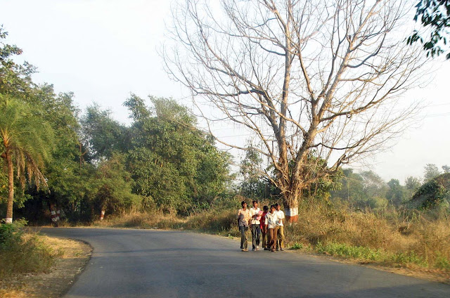 boys walking with books in rural india
