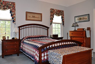 Shaker-style bed with PA Amish quilt