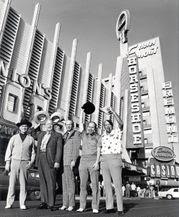 Johnny Moss, Chill Wills, Amarillo Slim, Jack Binion, and Puggy Pearson outside of Binion's Horseshoe during the 1974 WSOP