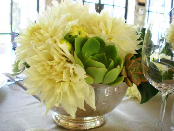 Green succulents and white dinner plate Dahlias in a vintage silver revere bowl by Lily Lodge